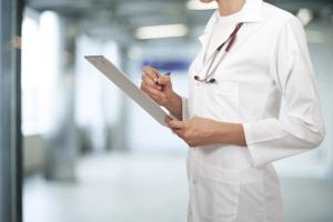 Hospital employee with chart
